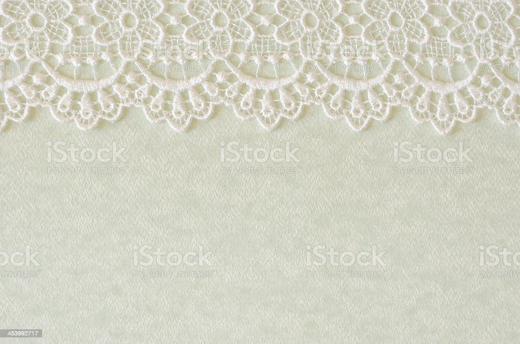 Light green marbled background with a white lace overlay  stock photo