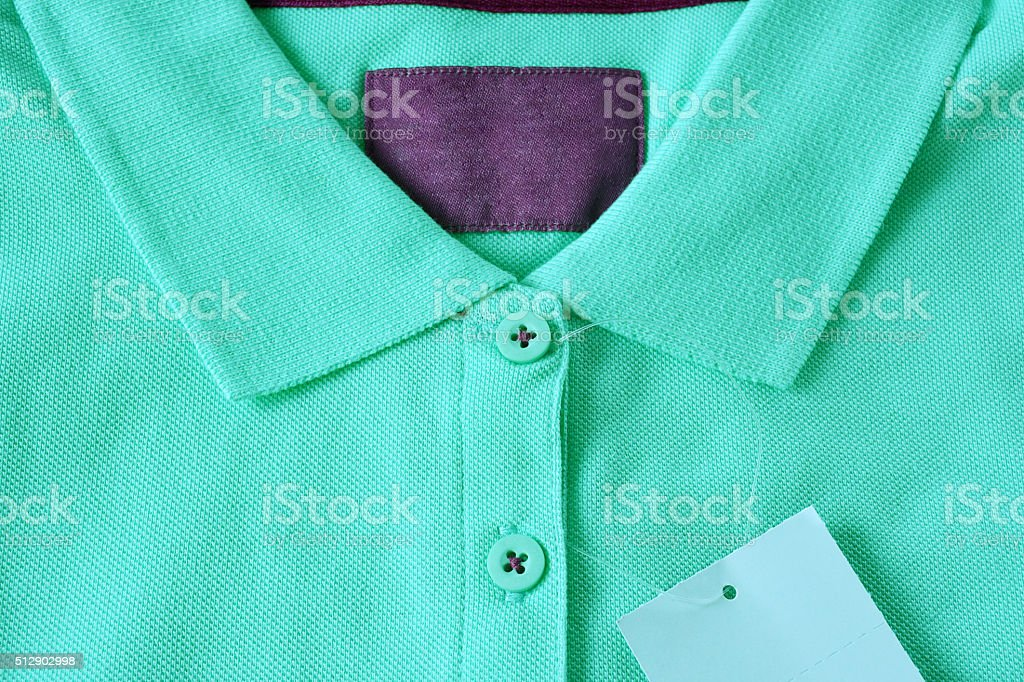 Light green polo t-shirt and blank label. stock photo