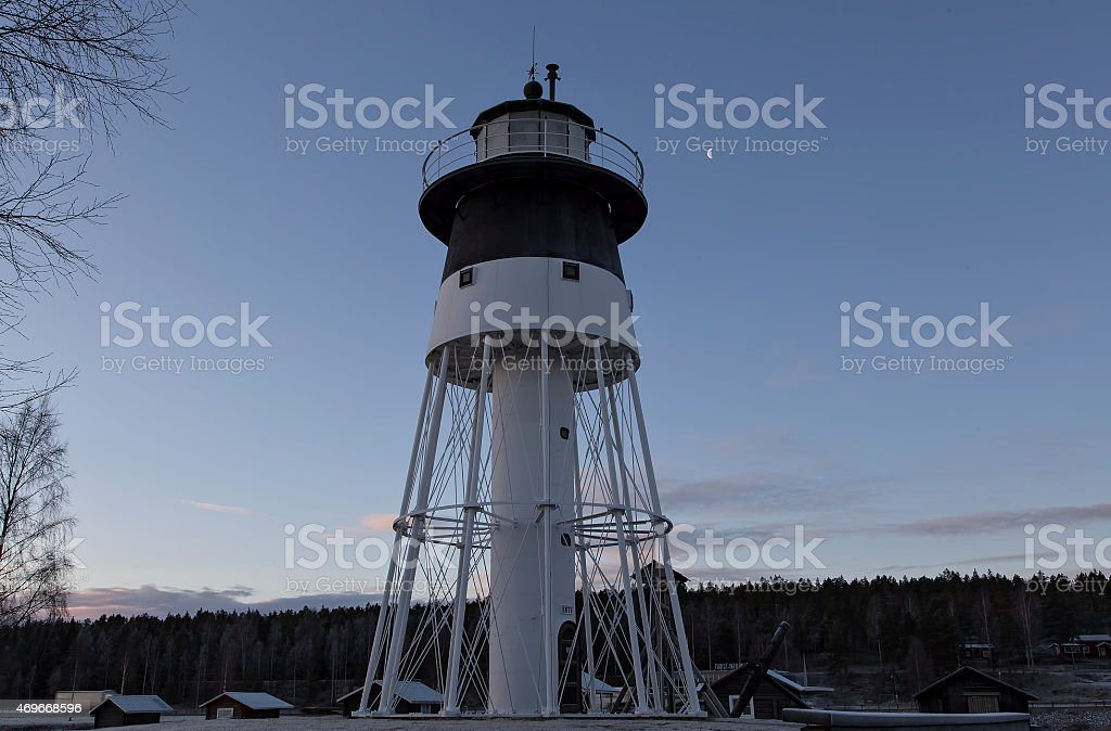Light house and the moon royalty-free stock photo