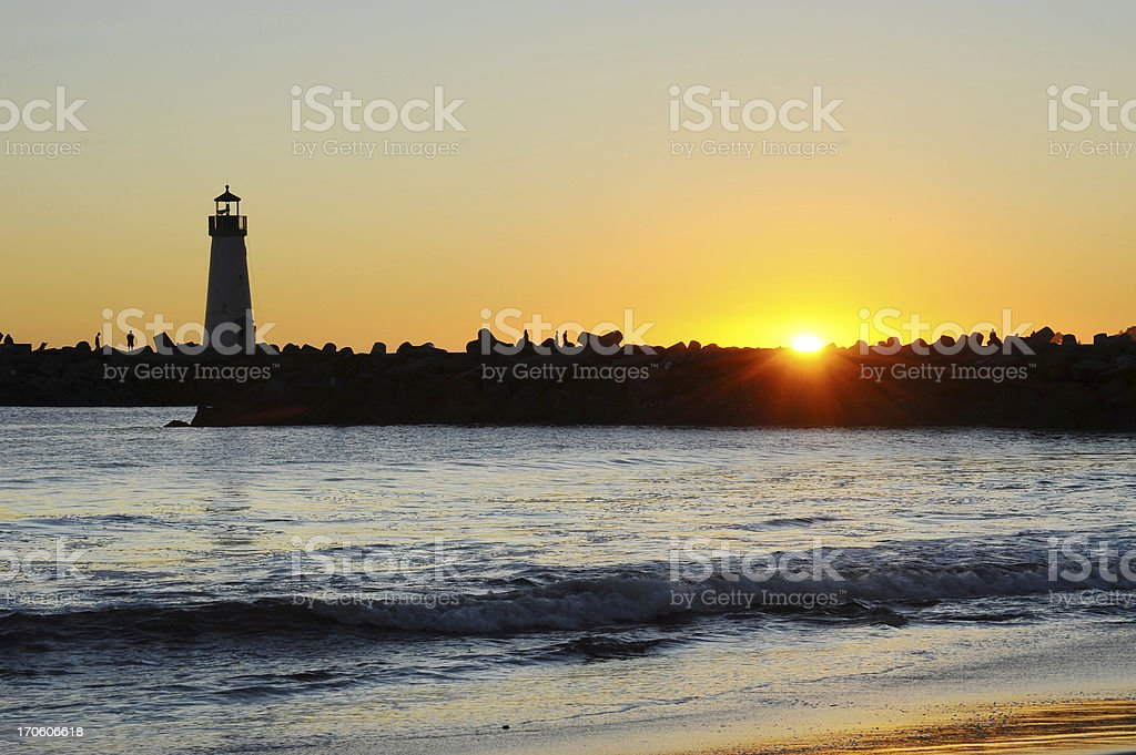 Light house with sunset in the background royalty-free stock photo