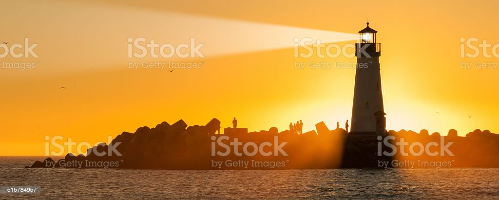 Light house with sunset in the background stock photo