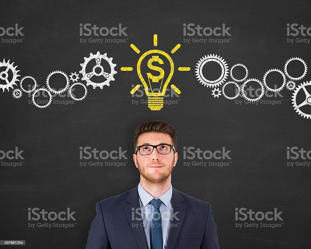 light idea finance bulb above head isolated on chalkboard background stock photo