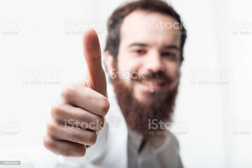 light image of thumbs up stock photo