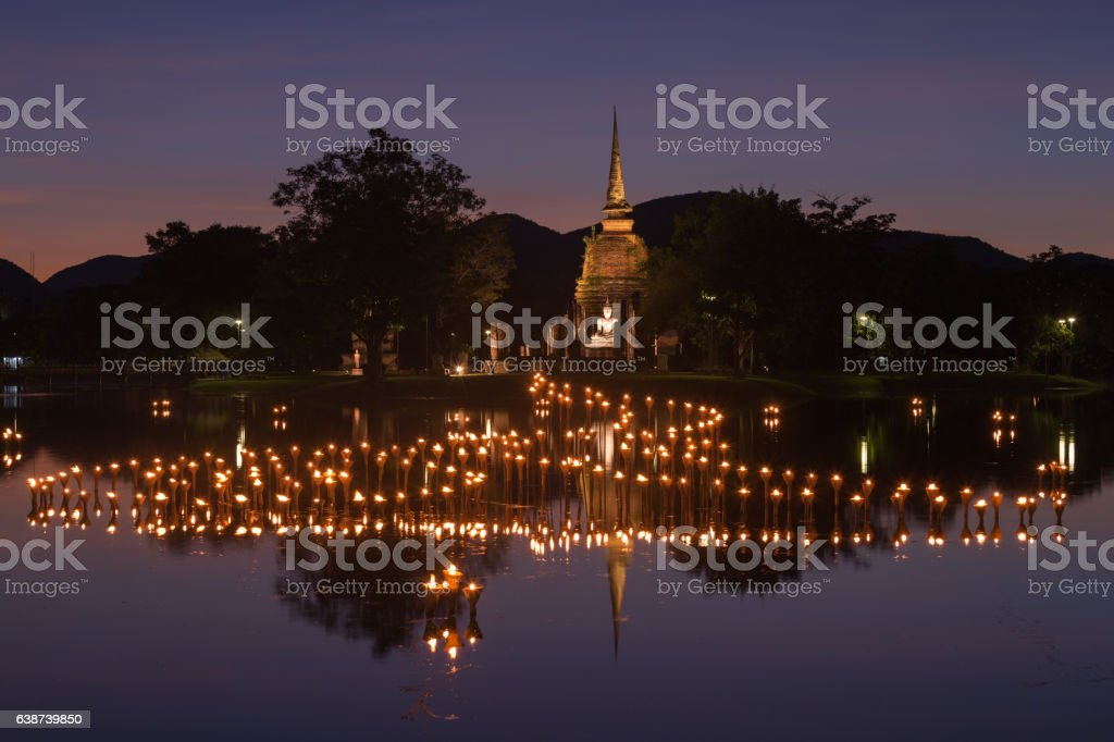 light in Buddha Statue in Loy Kratong Festival, Sukhothai Histor stock photo