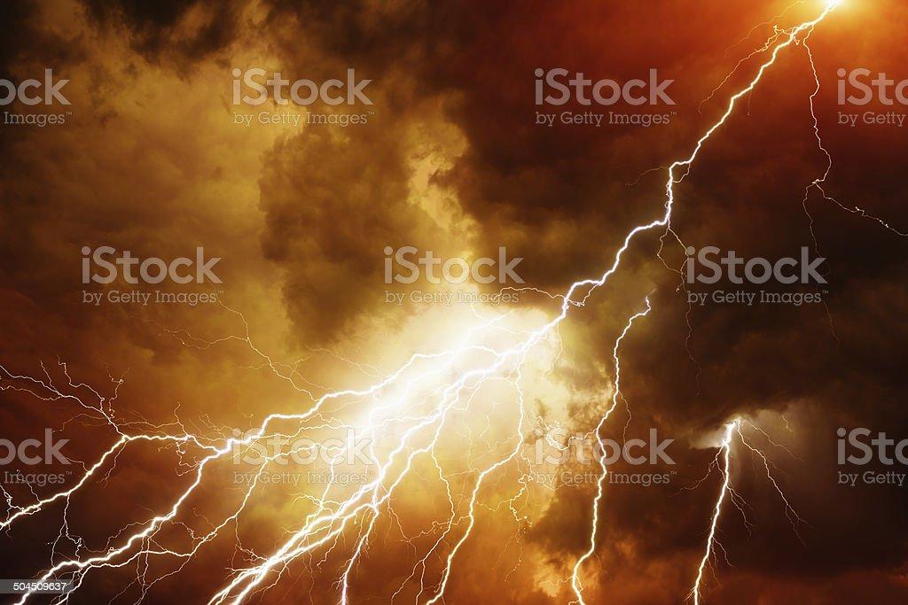 Light in dark red sky stock photo