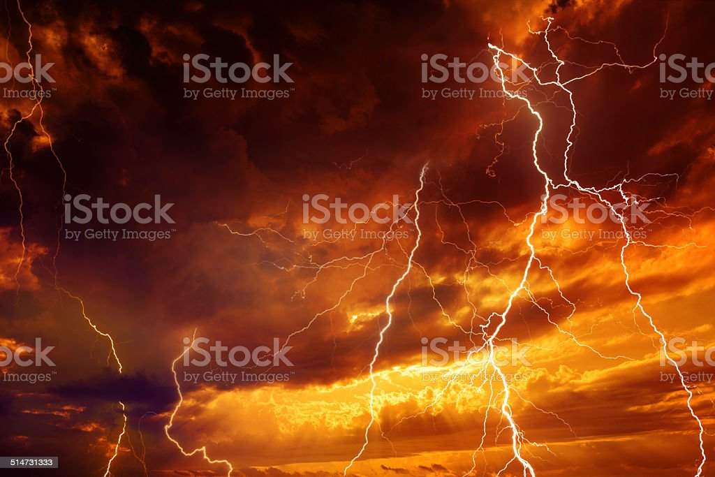 Light in dark red sky stock photo