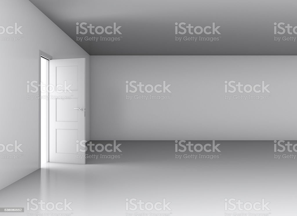 Light in empty room through opened door stock photo