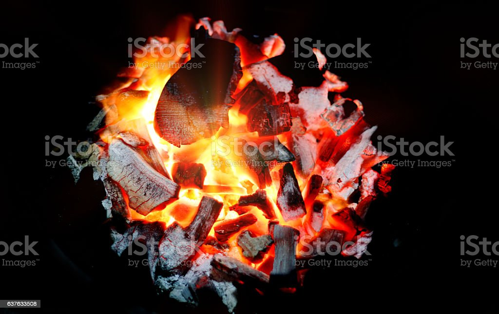 light in flame burning coal stock photo