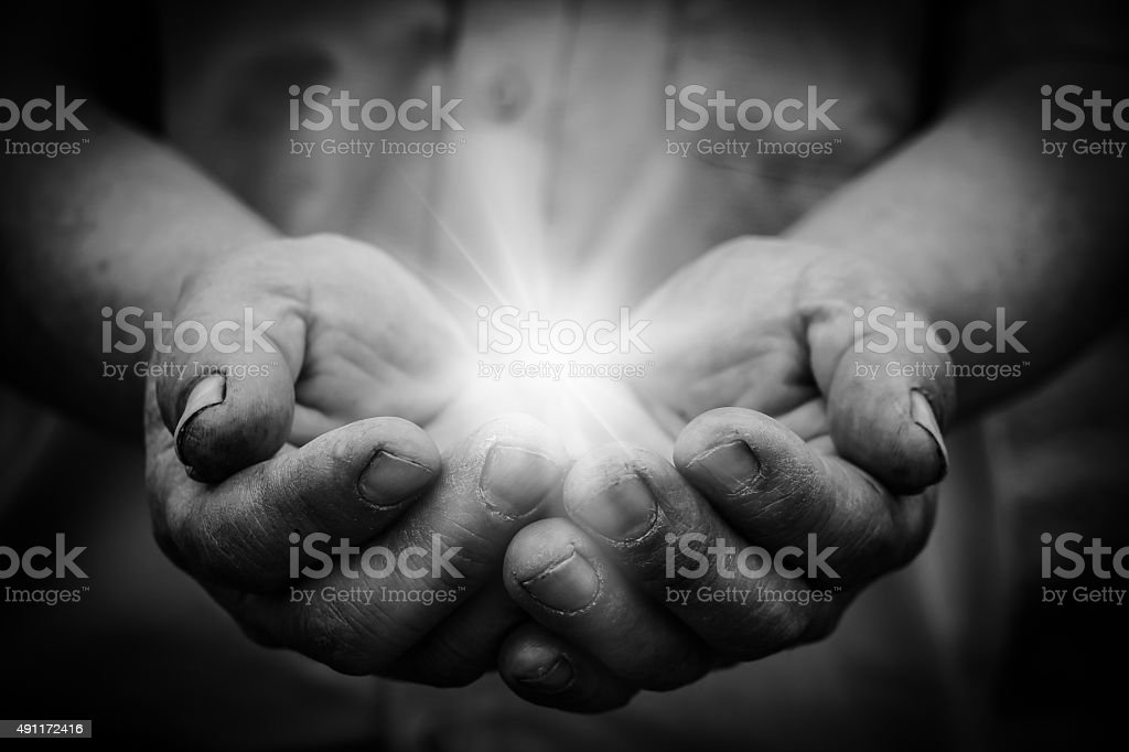 Light in hand stock photo