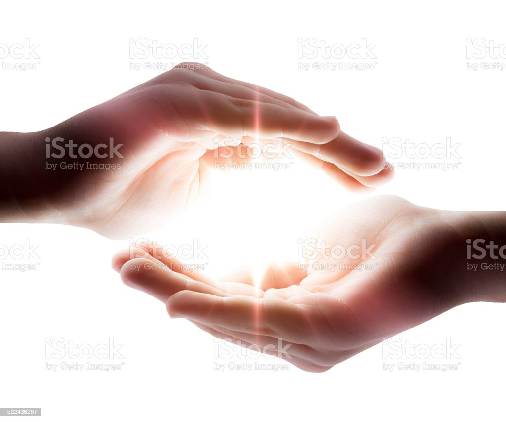 light in hands stock photo