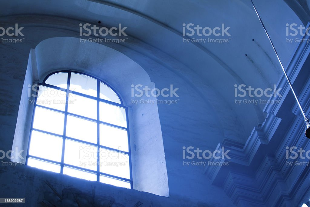 Light in the darkness: sunbeams from window royalty-free stock photo