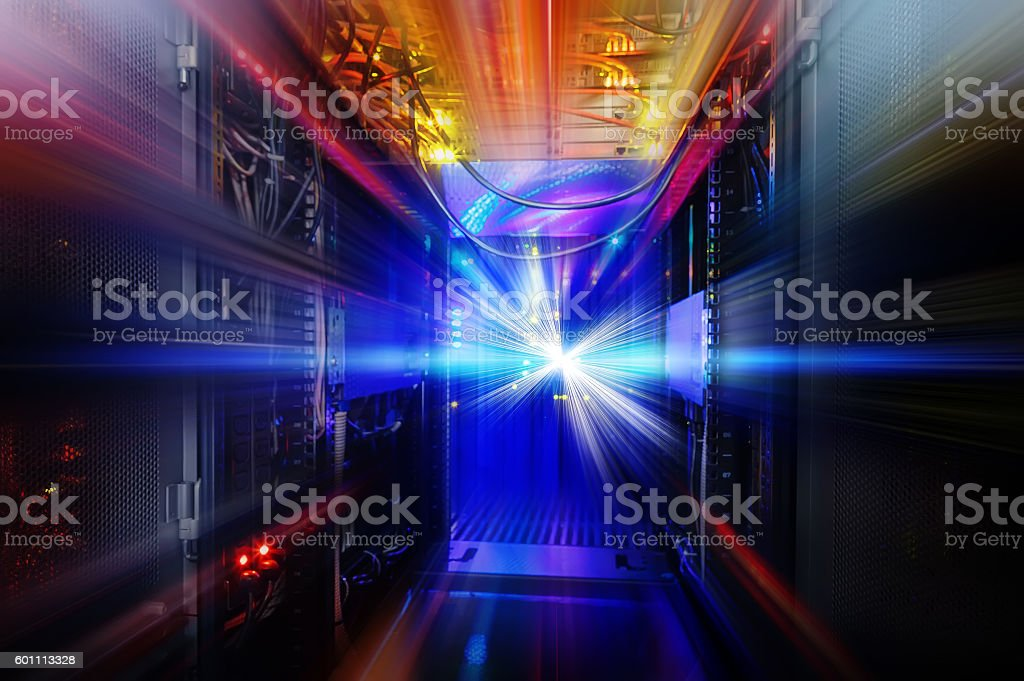 light indicators and motion on mainframe data center in dark stock photo