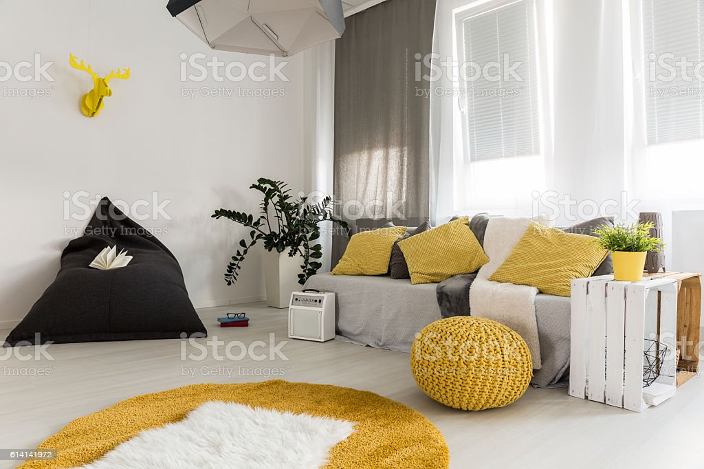 Light living room with yellow details idea stock photo
