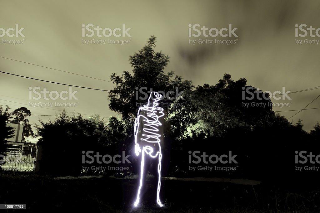 Light Man standing in garden royalty-free stock photo