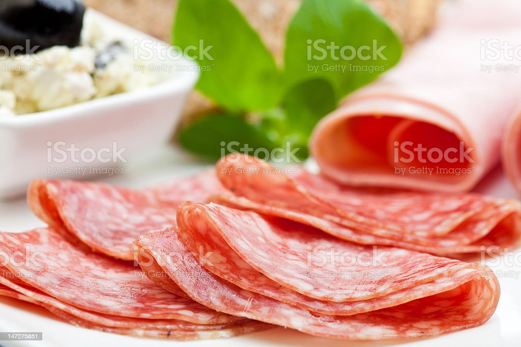 Light meal of salami, ham and feta cheese stock photo