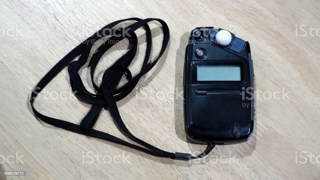 Light meter black color on the wood texture table. stock photo