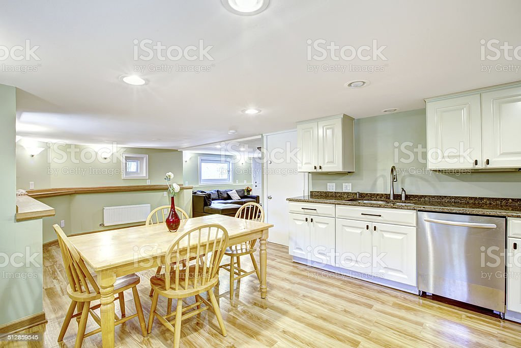 Light mint basement kitchen room. Mother-in-law apartment stock photo