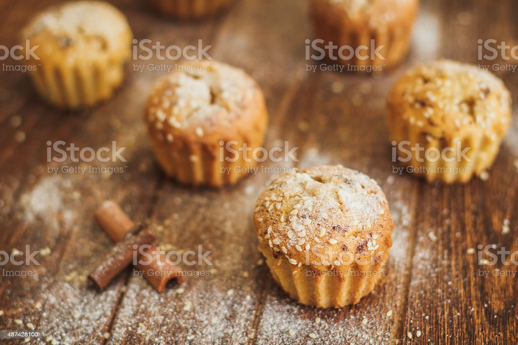 Light muffins with sesame on dark wooden background stock photo