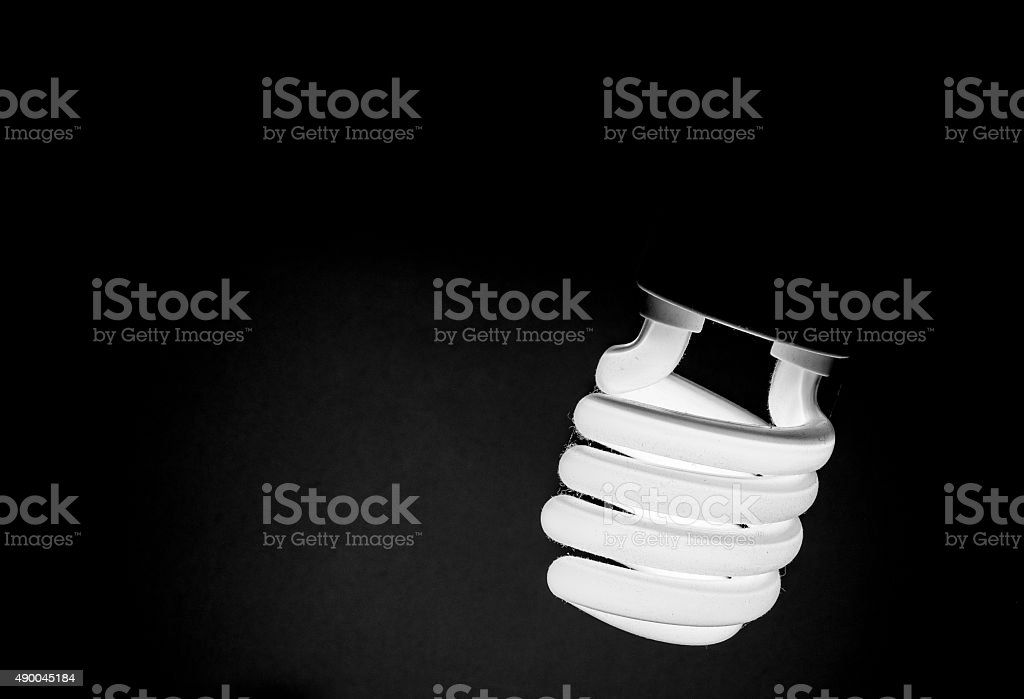 light of dirty bulb in black and white stock photo