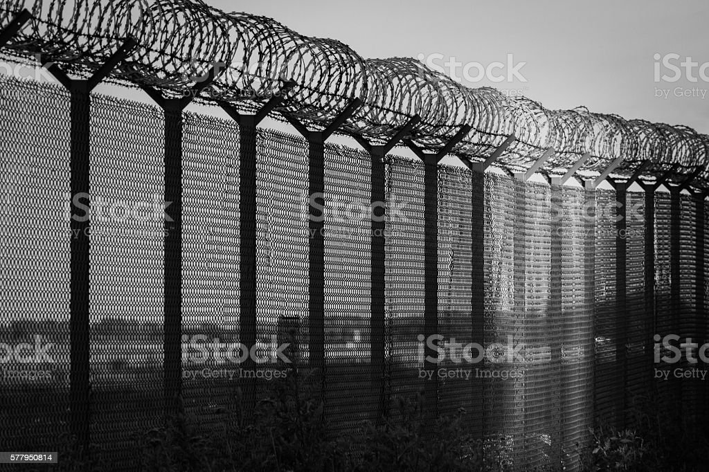 Light of hope - restricted area, black and white stock photo