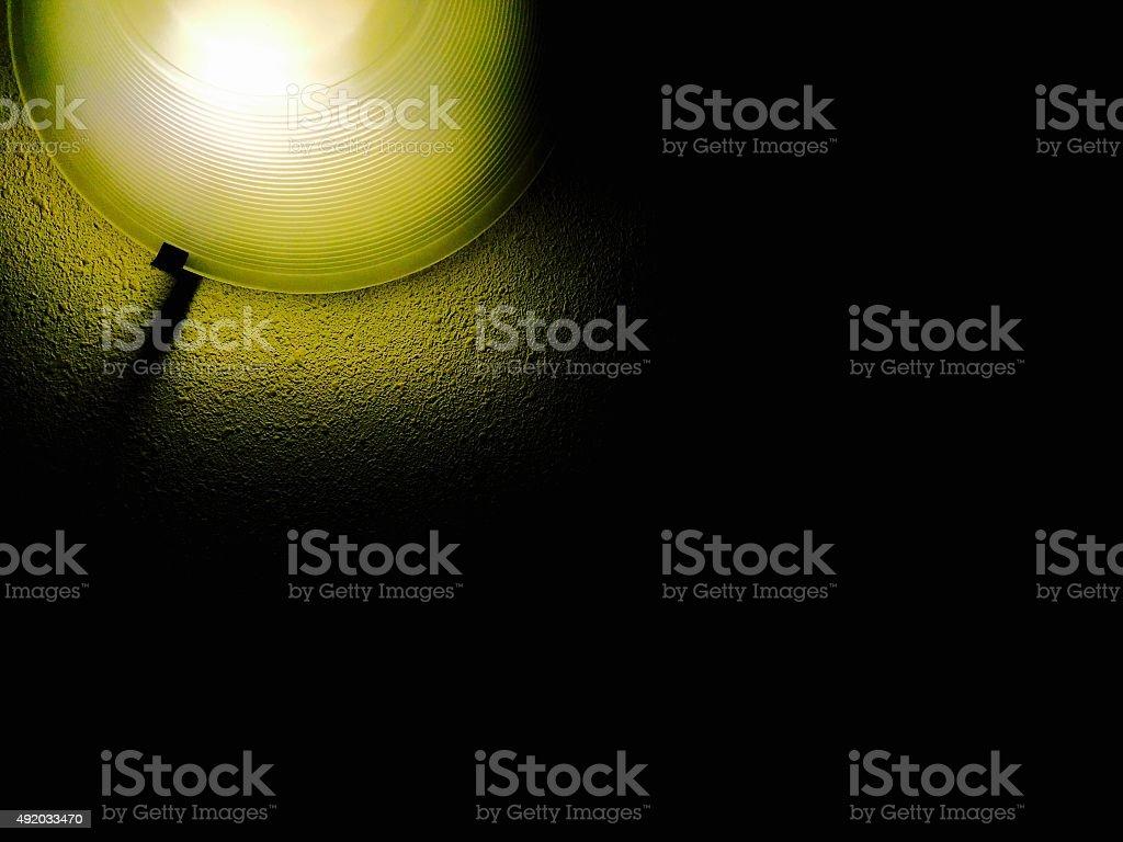 Light on dark wall background royalty-free stock photo