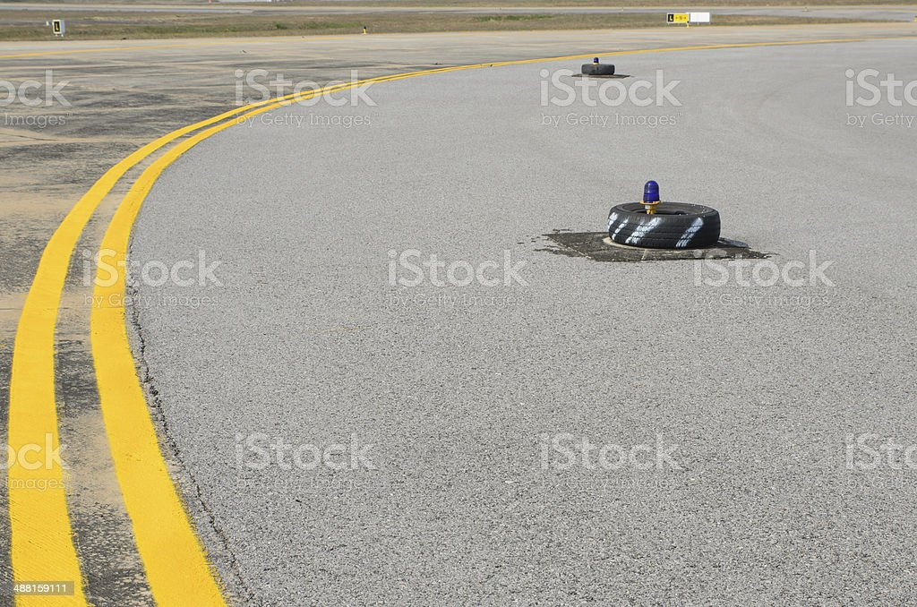 Light on taxiway stock photo