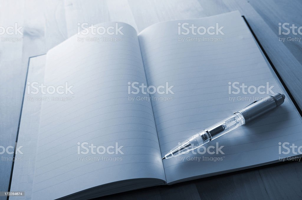 light pen on book royalty-free stock photo
