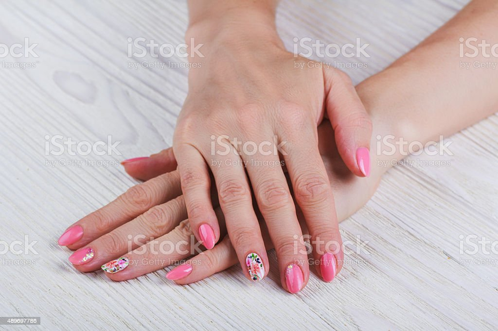 Light pink nail art with printed flowers stock photo