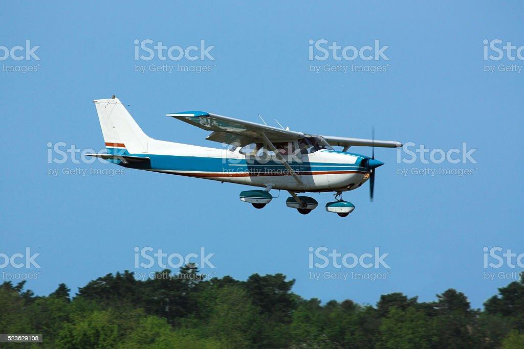 Light plane on final stock photo