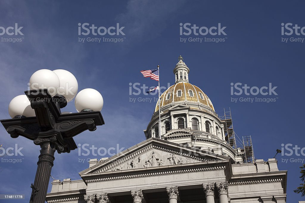 Light pole and Colorado Capitol with scaffolding stock photo