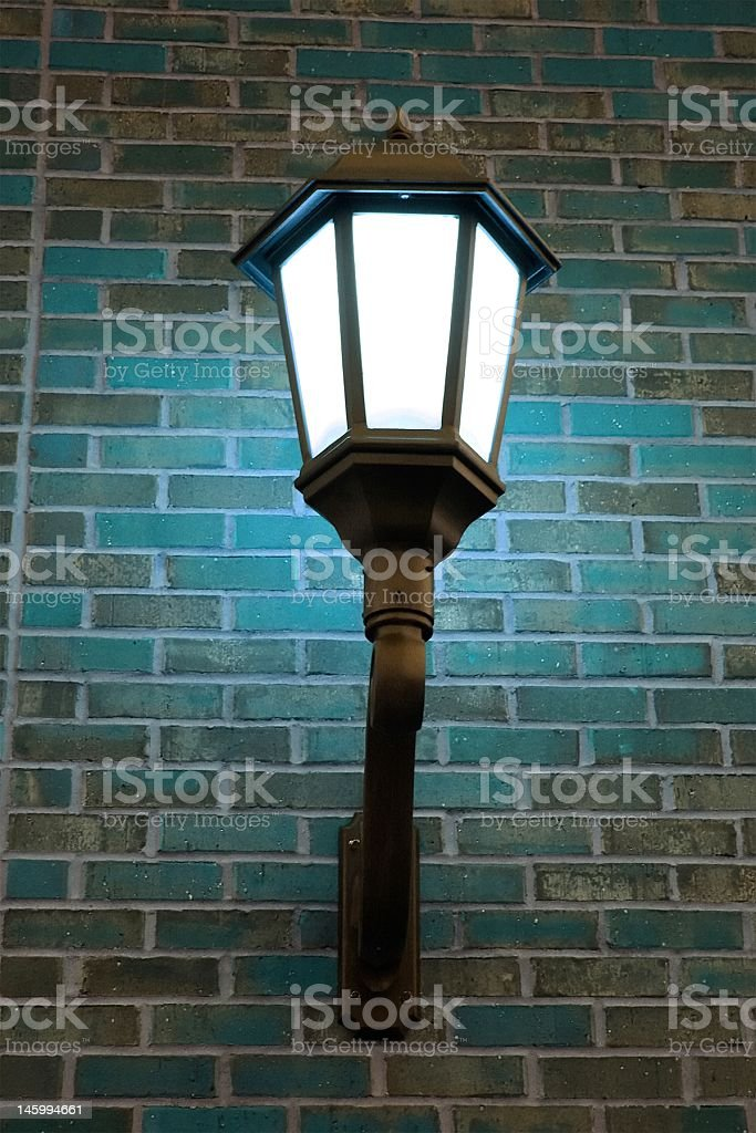 Light Post on Brick Wall royalty-free stock photo