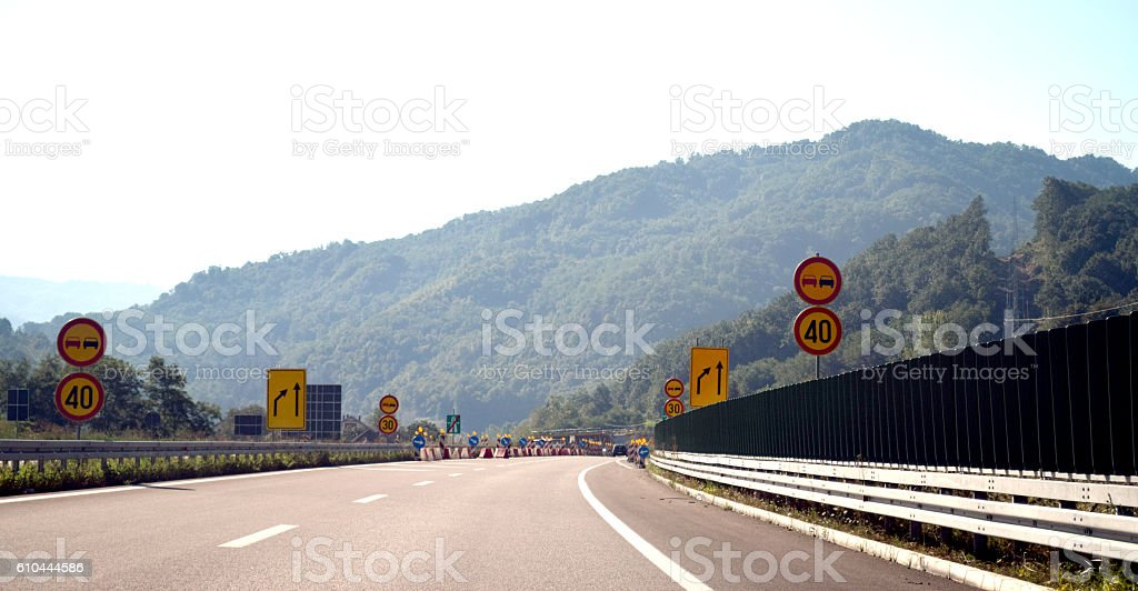 Light protection fence by the highway, and traffic signs stock photo