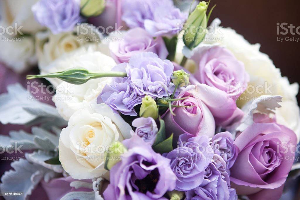 Light purple and white roses in wedding bouquet stock photo