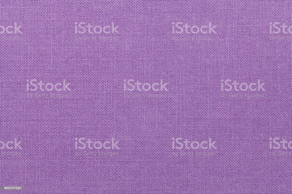light purple background from a textile material. Fabric with natural texture. Backdrop. stock photo