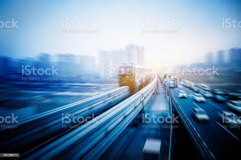 light rail moving on railway in chongqing stock photo