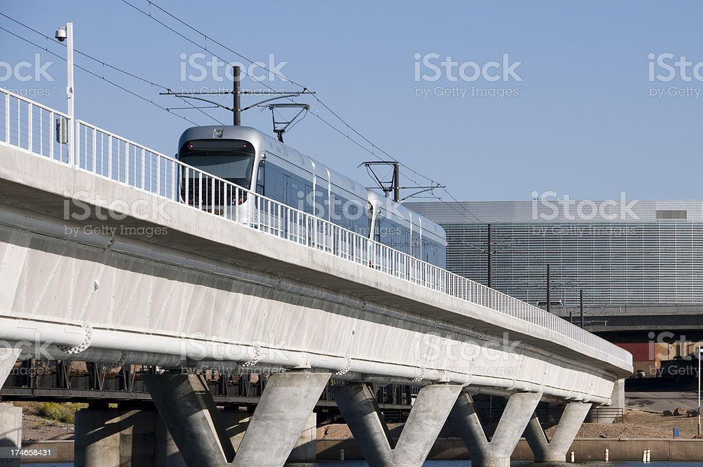 Light rail train and office building royalty-free stock photo