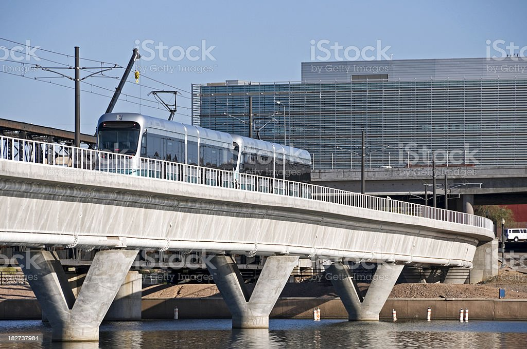 Light rail train crossing lake royalty-free stock photo