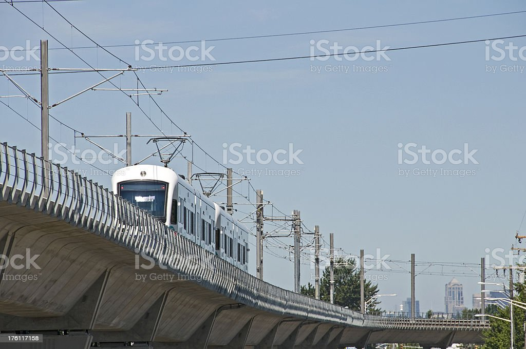 Light rail train northbound on raised track stock photo