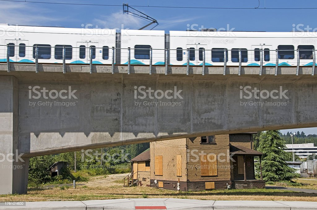Light rail train over condemned property stock photo