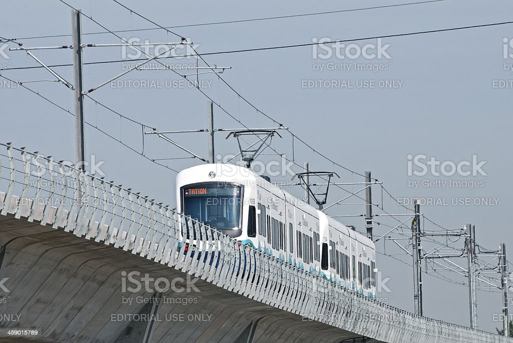 Light rail train running on raised tracks in Seattle stock photo