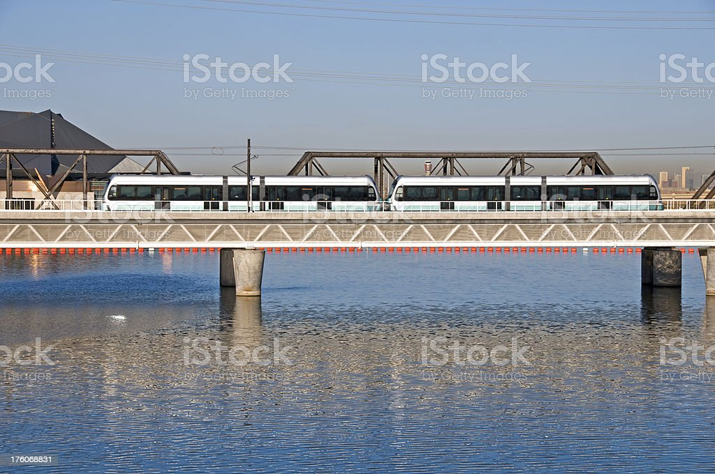 Light rail train running over man-made lake in Tempe royalty-free stock photo