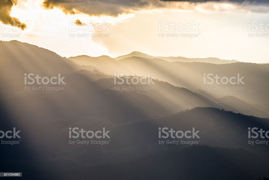light rays or tyndall effect on mountain stock photo