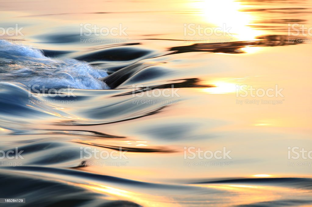 Light reflecting on flowing water stock photo