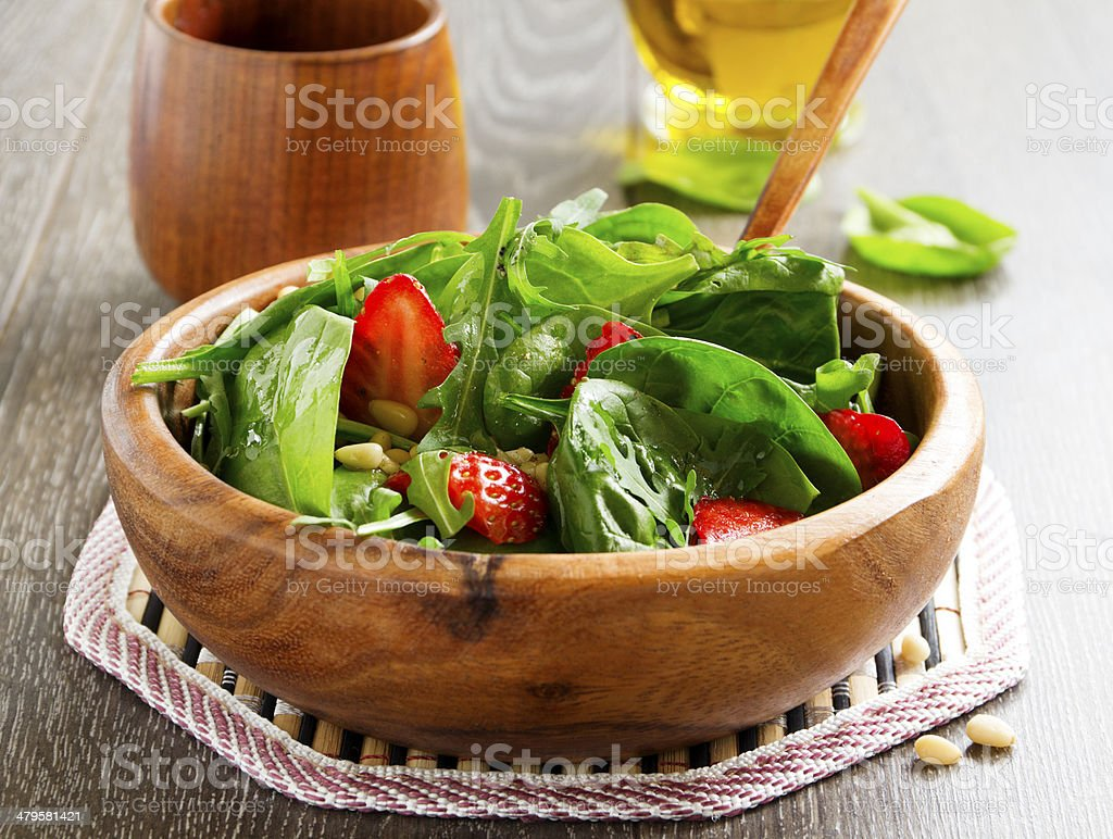 Light salad with spinach and strawberries. stock photo