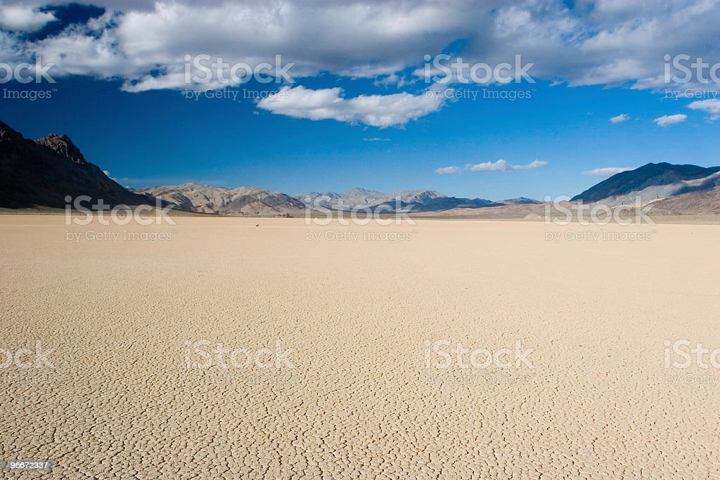Light sandy racetrack under bright blue skies stock photo