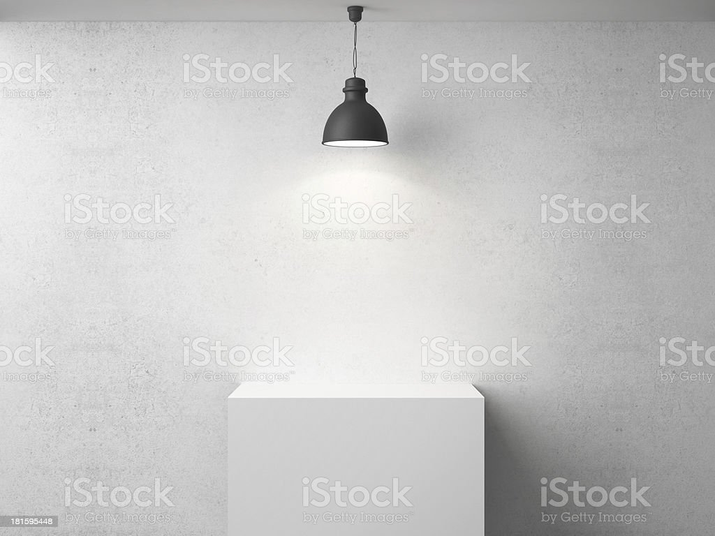 A light shines onto a white table from above stock photo