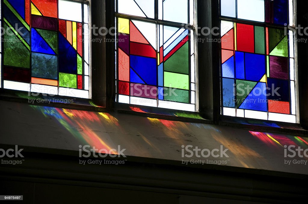 Light Shines Through a Stained Glass Window royalty-free stock photo