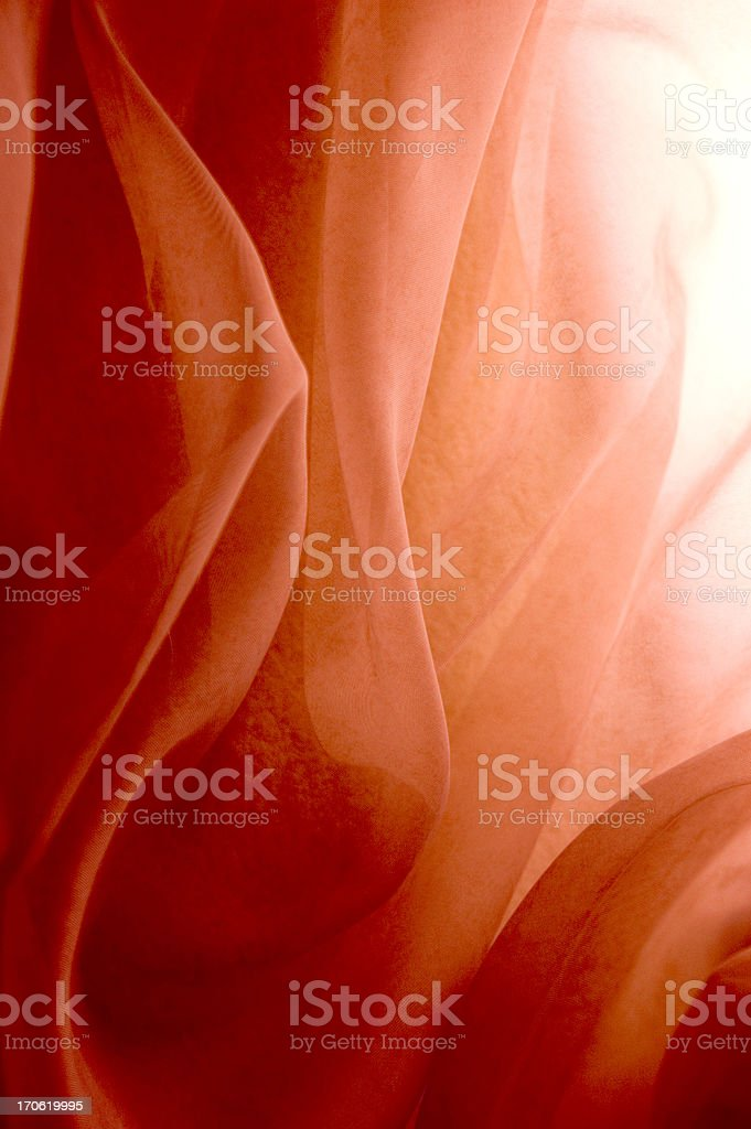 Light shines through rose-colored fabric royalty-free stock photo