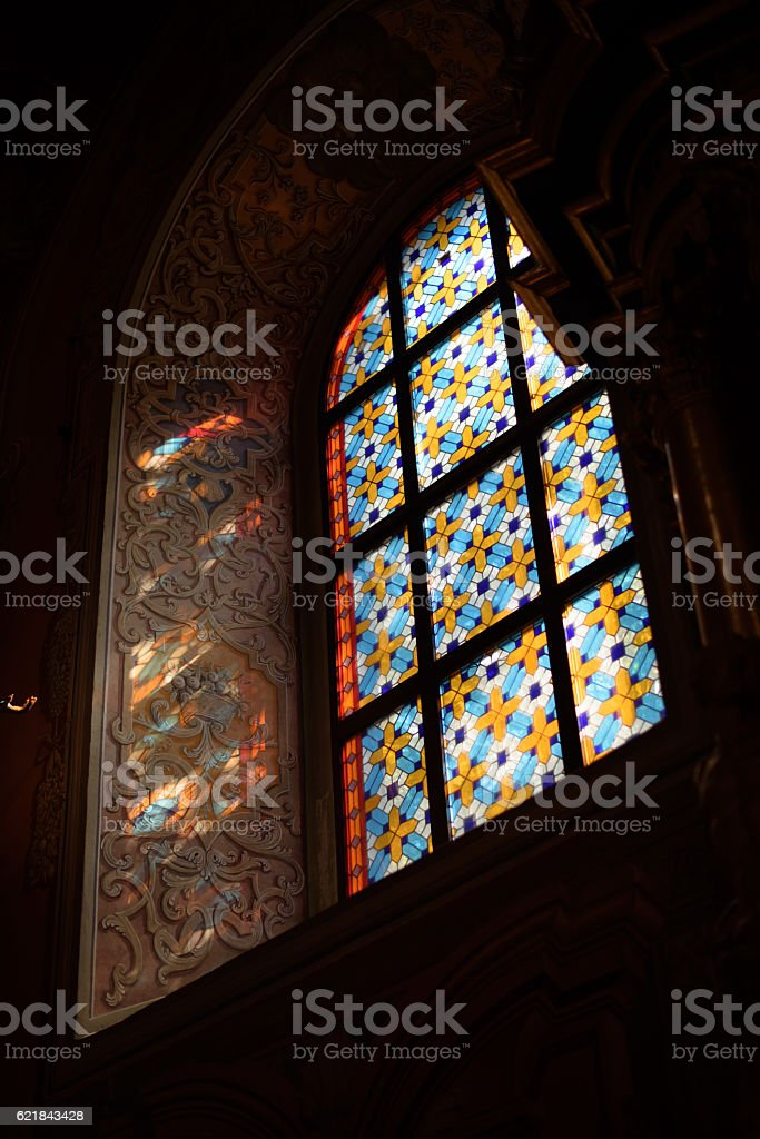 Light shines through the window in church stock photo