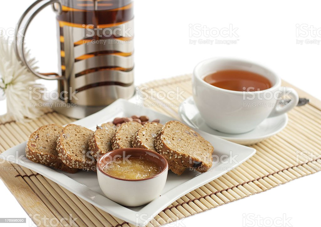 Light snack of tea and corn bread with honey royalty-free stock photo
